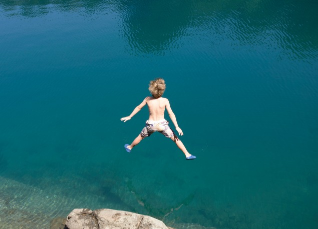 boy_jumping_diving_into_lake_or_river_635px.jpg