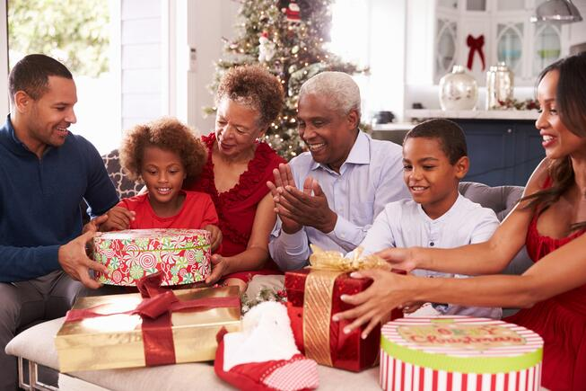 iStockphoto family unwrapping Christmas gifts.jpg