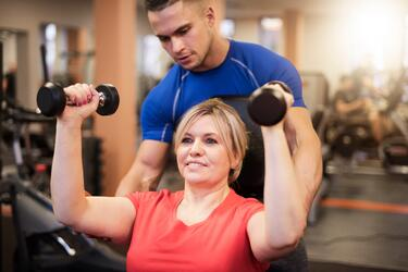 iStockphoto woman working with personal trainer.jpg